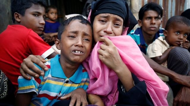 a-rohingya-muslim-woman-and-her-son-cry-after-being-caught-by-border-guard-bangladesh-while-illegally-crossing-at-a-border-check-point-in-coxs-bazar_5752865